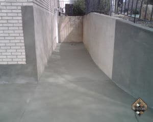 Driveway Overlay In Plain Gray With Retaining Wall