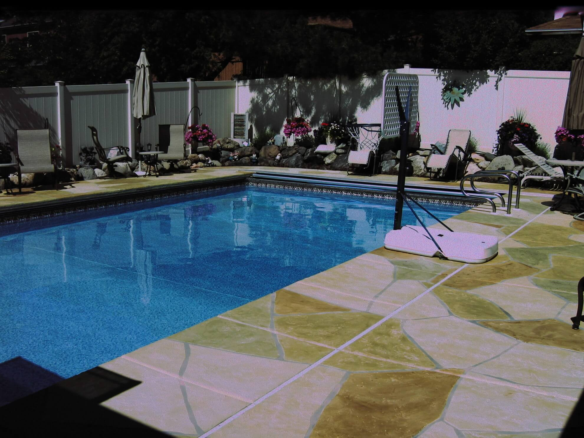 Flagstone pool deck concrete design systems salt lake for Pool design utah