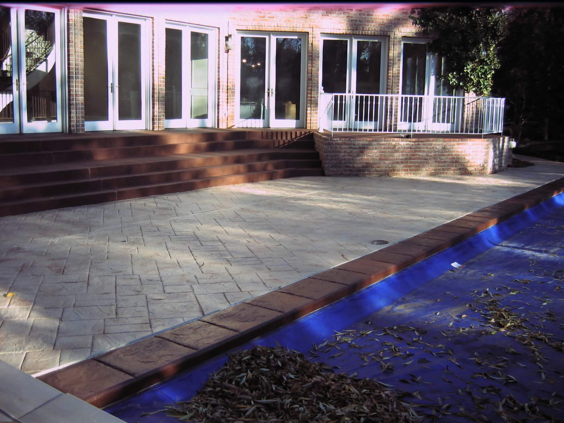 Pool deck newlook color stained concrete design systems for Pool design utah