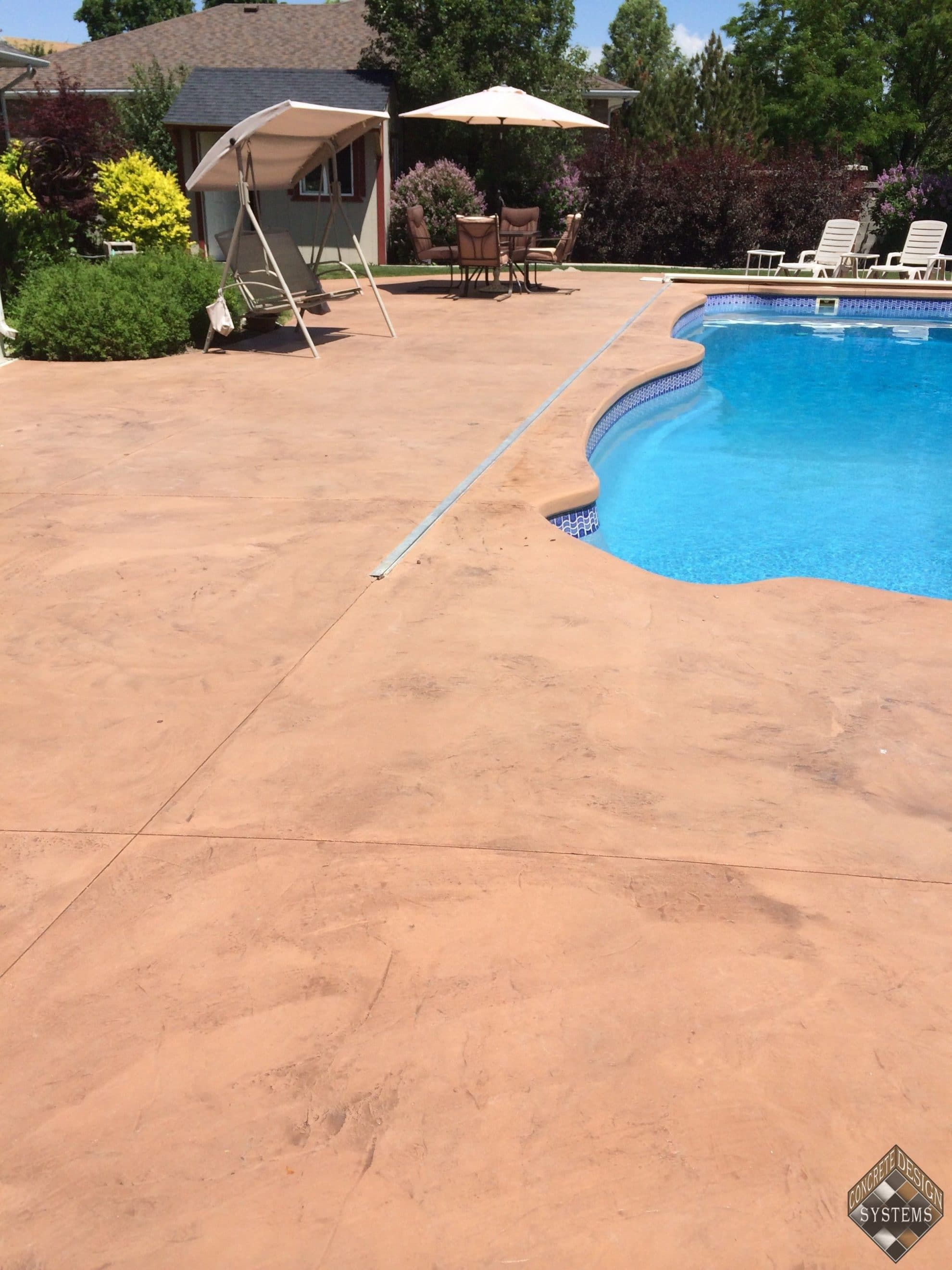 Restored new look pool deck concrete design systems for Pool design utah